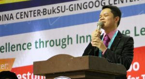 September 2017 Licensure Examination for Teachers Top 9 passer Jestonie Y. Dadobo gives his message as the guest speaker in the 13th Joint Commencement Exercises of the external studies center in Gingoog, Medina and Magsaysay, Misamis Oriental. The ceremonies were held in a gymnasium in Gingoog City/Courtesy of the Office of the External and Extension Studies Center Coordinator