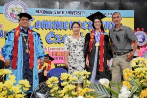 Doreen Khrystel P. Gonzales, who graduates cum laude and receives leadership and special awards, pose with her parents and Dr. Oscar B. Cabañelez, university president during the 84th Commencement Exercises at the BukSU Gymnasium, Malaybalay City, Philippines Photo courtesy of Christopher Cordova/BukSU ICTU
