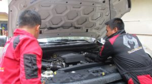 Automotive technology students attend to a vehicle for repair in the Bukidnon State University laboratory shop IPS photo courtesy of CSDT Technology Department